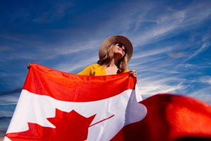 A woman holding a Canadian flag