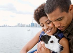 Couple with dog by lake in Toronto, Canada