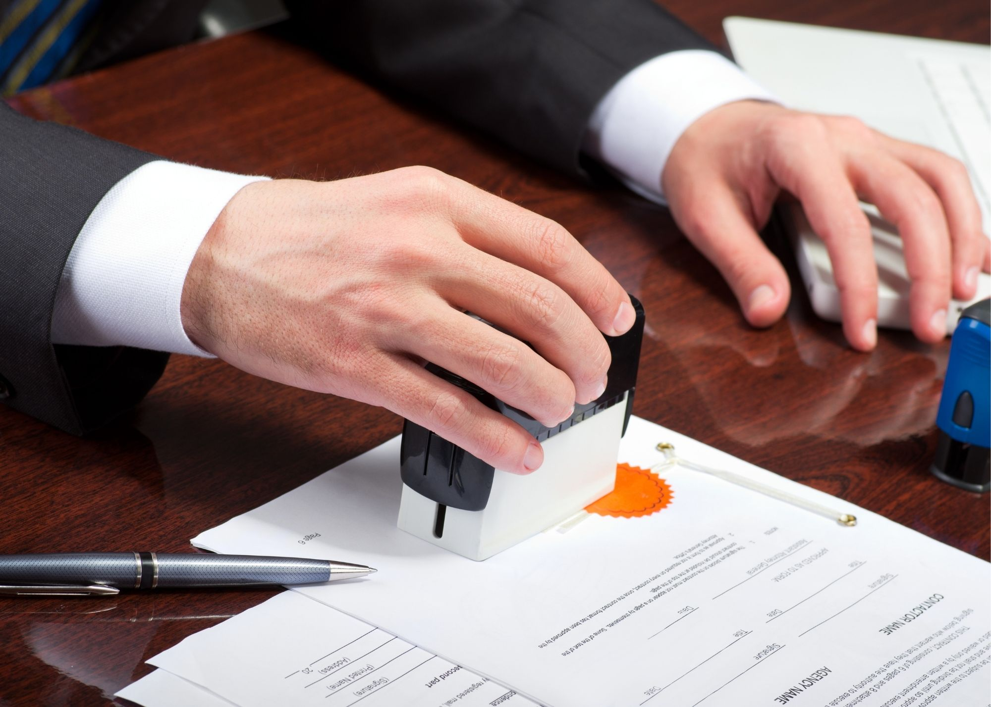 placing stamp on a contract